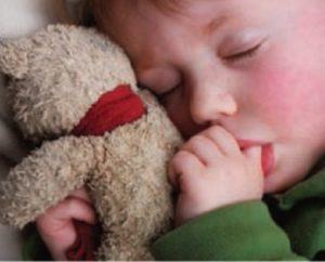 Sick child with teddy bear